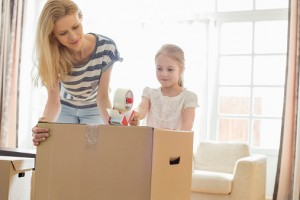 Mother and daughter with moving box