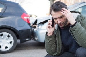 Man Calling Lawyer After Car Crash