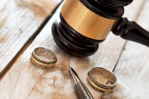 Close up of wedding rings and judge gavel