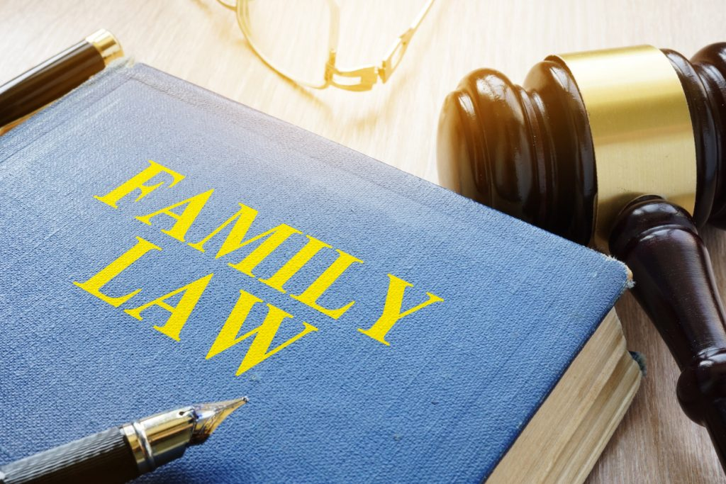 Family law and glasses on a court table.
